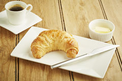 Croissant pastry on white dish Stock Images