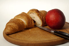 Croissant  and peach on the board Stock Photo