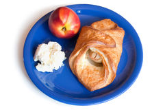 Croissant, peach and cream cheese on a plate Royalty Free Stock Photos