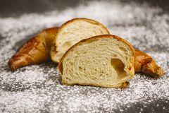 Croissant placed on a plate on a dark background. Stock Photos