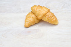 Croissant placed on wood Stock Photo
