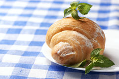 Croissant on plate Royalty Free Stock Photo
