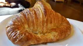 Croissant on the plate. Royalty Free Stock Image