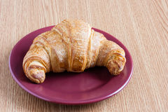 Croissant on a plate Royalty Free Stock Images
