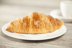 Croissant on plate Royalty Free Stock Image