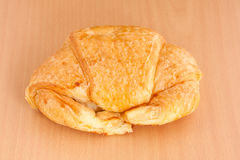 Croissant on plywood Royalty Free Stock Images