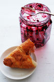 Croissant and  pot of jam Stock Photography