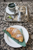 Croissant and Pot of Tea on Cafe Table Royalty Free Stock Photos