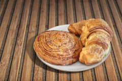 Croissant Puff Pastry Snail Rolls Sprinkled with Sesame Seeds on Bamboo Place Mat Royalty Free Stock Image