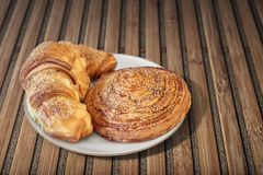 Croissant Puff Pastry Snail Rolls Sprinkled with Sesame Seeds on Stock Photo