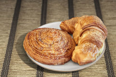 Croissant Puff Pastry Snail Rolls Sprinkled With Sesame Seeds Set On Plaited Parchment Place Mat Stock Photos