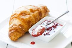 Croissant with raspberry Stock Photography