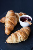 Croissant and raspberry jam Royalty Free Stock Photo