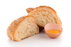 Croissant and raw egg Stock Images