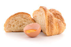 Croissant and raw egg. Fresh croissant and raw egg on white background Stock Photo