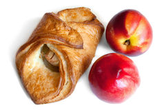 Croissant and red peaches isolation on white Stock Images