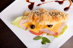 Croissant salami sandwich with cheese Royalty Free Stock Photos