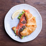 Croissant with salmon and capers Royalty Free Stock Photography