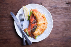 Croissant with salmon and capers Stock Image