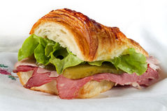 Croissant sandwich. With Corned Beef and ham Royalty Free Stock Image