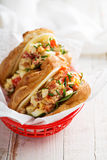 Croissant sandwich with egg salad and spinach Stock Image