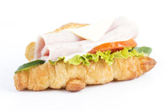 Croissant sandwich with ham cheese Stock Images