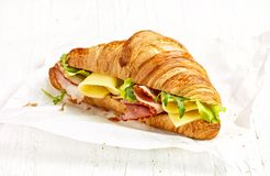 Croissant sandwich with ham and cheese royalty free stock photos