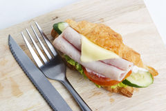 Croissant sandwich with ham cheese Stock Photo