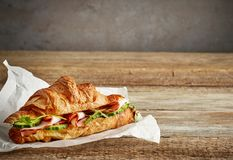 Croissant sandwich with ham and cucumber royalty free stock images