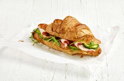 Croissant sandwich with ham and cucumber stock photos
