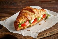 Croissant sandwich with mozzarella and tomato stock photography