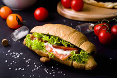 Croissant sandwich with salted salmon Stock Images