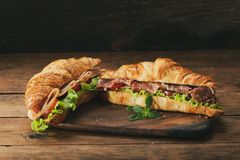 Croissant sandwiches with ham and vegetables royalty free stock photos