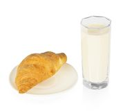 Croissant on a saucer and the glass of milk Stock Photo