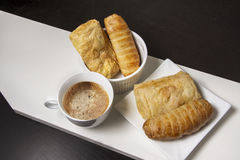 Croissant sausage with capuchin coffee. On white wood Stock Image
