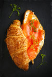 Croissant with smoked salmon and cream cheese. Royalty Free Stock Photo