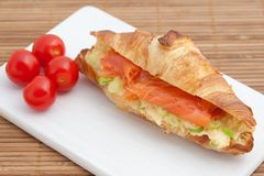 Croissant with smoked salmon and scrambled eggs Royalty Free Stock Image