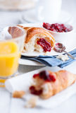 Croissant and sour cherry jam on white plates Stock Photography