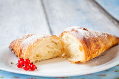 Croissant split with red currants Royalty Free Stock Images