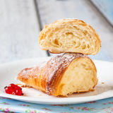 Croissant split with red currants Royalty Free Stock Photos