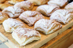 Croissant sprinkled with icing Royalty Free Stock Images