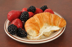 Croissant with strawberries and blackberries Stock Images
