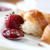 Croissant with strawberry jam Stock Photography