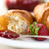 Croissant with strawberry jam Royalty Free Stock Image