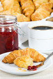 Croissant and strawberry jam Stock Image