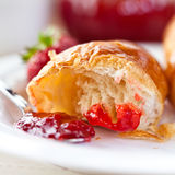 Croissant with strawberry jam Stock Photos