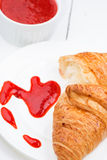 Croissant and strawberry jam Stock Photo