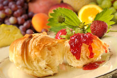 Croissant with strawberry jam Royalty Free Stock Photo