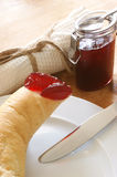Croissant with strawberry jam for breakfast Stock Images