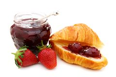 Croissant with strawberry jam and fresh berries. Stock Photo